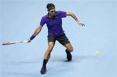 Switzerland's Roger Federer hits a return to Britain's Andy Murray during their men's singles semi-final tennis match at the ATP World Tour Finals at the O2 Arena in London November 11, 2012. REUTERS/Suzanne Plunkett