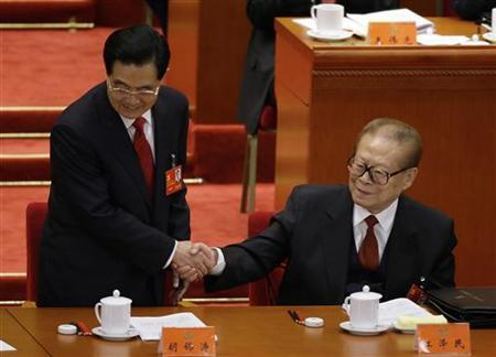 China's President Hu Jintao (L) shakes hands with former President Jiang Zemin after Hu delivered a speech at the opening ceremony of the 18th National Congress of the Communist Party of China at the Great Hall of the People in Beijing November 8, 2012. REUTERS/Jason Lee