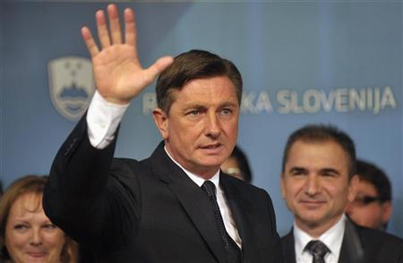 Presidential candidate Borut Pahor reacts at a press conference after leading in first round of presidential elections in Ljubljana November 11, 2012. REUTERS/Srdjan Zivulovic