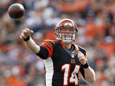 Cincinnati Bengals quarterback Andy Dalton (14) throws under pressure from New York Giants during the first half of play in their NFL football game at Paul Brown Stadium in Cincinnati, Ohio, November 11, 2012. REUTERS/John Sommers II