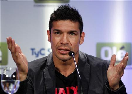 WBC middleweight champion Sergio Martinez of Argentina gestures during a news conference in Buenos Aires, October 22, 2012. REUTERS/Marcos Brindicci