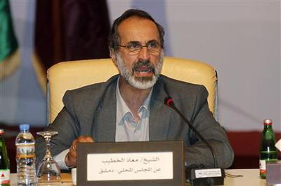 Syria's opposition groups strike unity deal against...