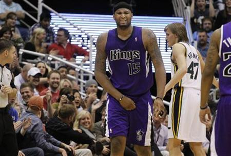 Sacramento Kings forward DeMarcus Cousins (15) holds his groin after getting hit by a ball during the second half of their NBA basketball game against the Utah Jazz in Salt Lake City, Utah, March 5, 2011. REUTERS/Jim Urquhart