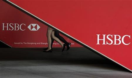 Passersby walk inside HSBC headquarters in Hong Kong July 30, 2012. REUTERS/Bobby Yip