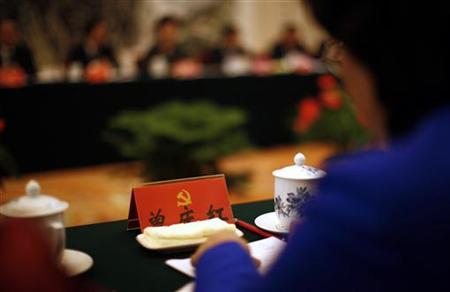 A delegate attends a meeting at the Great Hall of the People, venue of the 18th National Congress of the Communist Party of China, in Beijing November 9, 2012. REUTERS/Carlos Barria