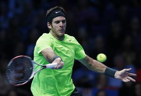 Argentina's Juan Martin Del Potro hits a return to Serbia's Novak Djokovic during their men's singles semifinal tennis match at the ATP World Tour Finals at the O2 Arena in London November 11, 2012. REUTERS/Suzanne Plunkett