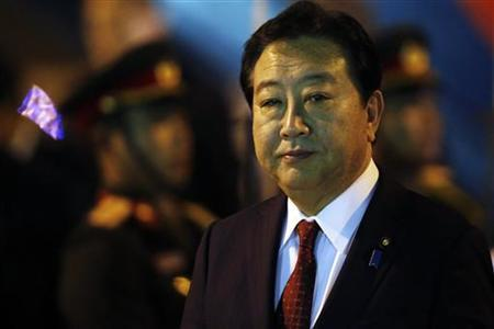 Japan's Prime Minister Yoshihiko Noda arrives at Vientiane airport November 4, 2012. REUTERS/Damir Sagolj