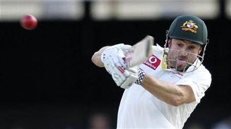 Australia's Ed Cowan plays a shot against South Africa during the first test cricket match at the Gabba in Brisbane November 11, 2012. REUTERS/Aman Sharma