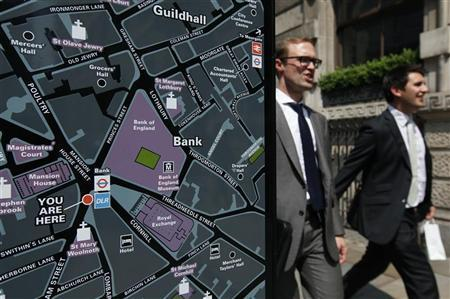 People walk past a map in the financial district in the City of London May 24, 2012.REUTERS/Suzanne Plunkett