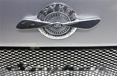 The logo of Dutch car manufacturer Spyker is placed on the bonnet of a Spyker C8 Aileron Spyder car during the first media day of the 80th Geneva Car Show at the Palexpo in Geneva March 2, 2010. REUTERS/Valentin Flauraud