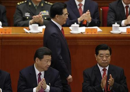 China's Vice President Xi Jinping and top political advisor Jia Qinglin applaud as China's President Hu Jintao walks past after delivering speech at the opening ceremony of 18th National Congress of the Communist Party of China at the Great Hall of the People in Beijing, November 8, 2012. REUTERS/Jason Lee