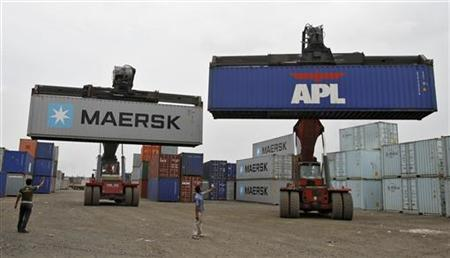 Mobile cranes prepare to stack containers at Thar Dry Port in Sanand in Gujarat July 2, 2012. REUTERS/Amit Dave/Files