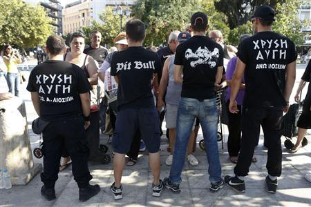 Supporters of Greece's Golden Dawn extreme right party secure an area where fellow party supporters are distributing food to residents suffering from the economic crisis at the Syntagma square in Athens in this August 1, 2012 file photo. REUTERS/Yorgos Karahalis/Files