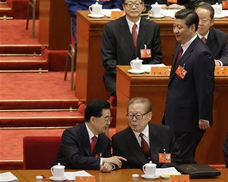 China's Vice President Xi Jinping walks behind as China's outgoing President Hu Jintao (L) talks with former President Jiang Zemin at the beginning of the opening ceremony of 18th National Congress of the Communist Party of China at the Great Hall of the People in Beijing, November 8, 2012. REUTERS/Jason Lee