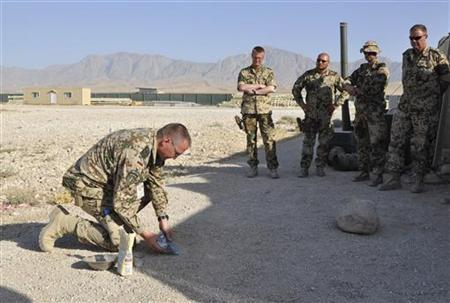 German army Bundeswehr bomb disposal expert, first Sergeant Daniel Z. (L) conducts a training course for German soldiers on how easy it is to mix explosives with sugar and chemicals that are readily available to the general public, at an army camp in Mazar-i-Sharif August 20, 2012. REUTERS/Sabine Siebold (AFGHANISTAN - Tags: MILITARY CONFLICT)