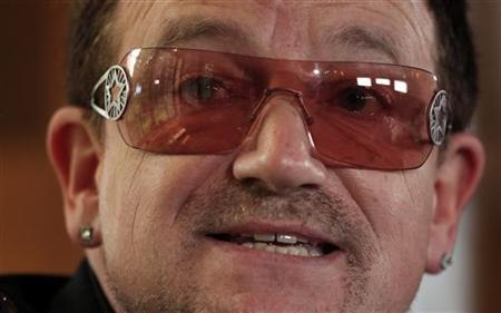 Singer Bono of the band U2 speaks at the opening session of the Oslo Forum in Norway June 18, 2012. REUTERS/Cathal McNaughton