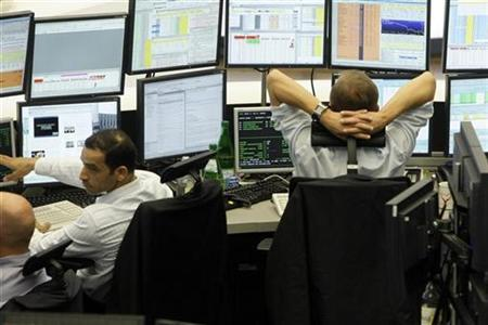 File photo of traders sitting in front of screens at the Frankfurt stock exchange September 19, 2008. REUTERS/Alex Grimm