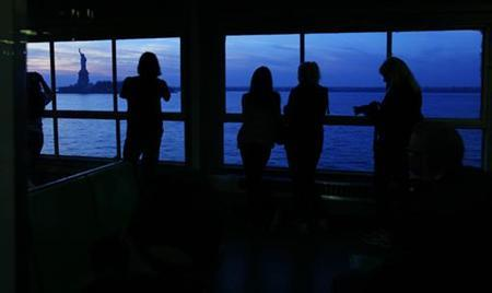 Commuters ride the Staten Island ferry in New York November 11, 2012. REUTERS/Carlo Allegri