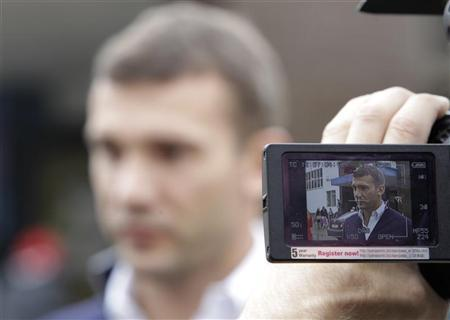 Andriy Shevchenko, a former soccer player and member of ''Ukraine Forward'' social democratic party, is seen on a monitor of a video camera while talking to the media during the parliamentary elections in Kiev, October 28, 2012. REUTERS/Vasily Fedosenko