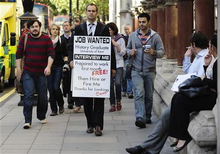 Jobless university graduate David Rowe wears a sandwich board advertising his search for employment as he walks along Fleet Street in central London September 22, 2009. REUTERS/Kieran Doherty