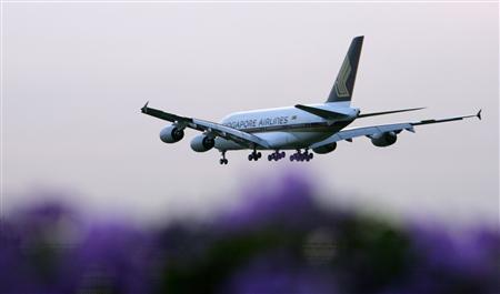 The first Airbus A380 superjumbo delivered to Singapore Airlines descends to land at Singapore's Changi Airport in this October 17, 2007 file photo. REUTERS/Tim Chong/Files