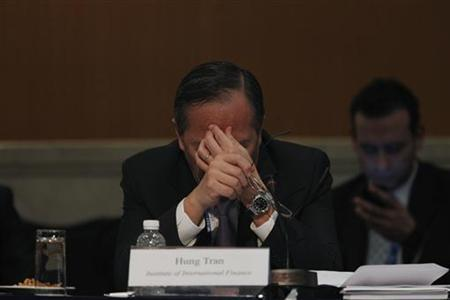 Institute of International Finance's (IIF) Deputy Managing Director Hung Tran massages his forehead during a meeting of finance ministers and central bankers from the Group of 20 top economies in Mexico City February 24, 2012. REUTERS/Tomas Bravo