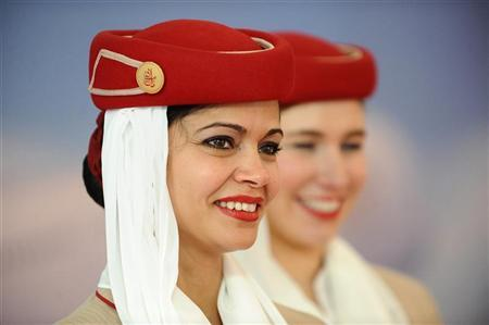 Emirates Airlines flight attendants look on during the World Route Development Strategy Summit at Abu Dhabi National Exhibition Centre, September 30, 2012. REUTERS/Ben Job