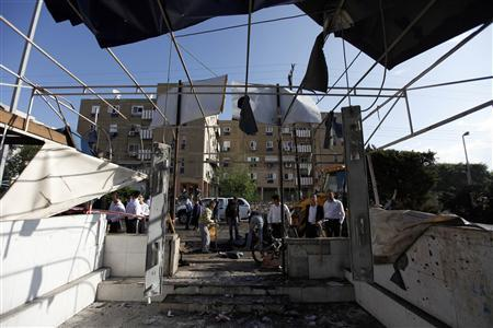 Israelis look at the damage to a house after a rocket fired by militants in Gaza landed in the southern town of Netivot November 12, 2012. REUTERS/Amir Cohen