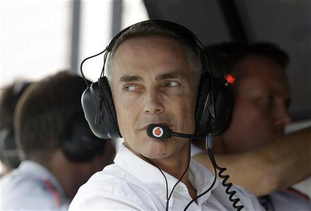 McLaren Formula One team principal Martin Whitmarsh looks back from the pit wall during the qualifying session of the Indian F1 Grand Prix at the Buddh International Circuit in Greater Noida, on the outskirts of New Delhi, October 27, 2012. REUTERS/Greg Baker/Pool