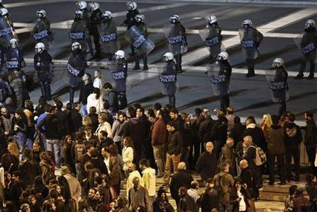 Protesters stand in front of riot police outside the parliament during a rally in central Athens November 11, 2012. REUTERS/John Kolesidis
