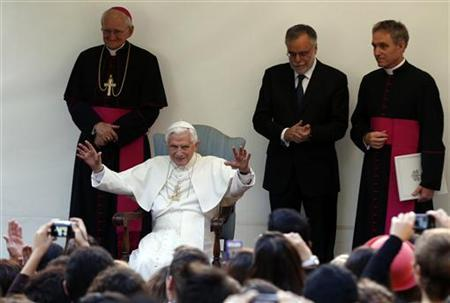 Pope Benedict XVI (R) waves as he visits an old people's home run by the Sant'Egidio Roman Catholic community in Rome November 12, 2012. REUTERS/Alessandro Bianchi