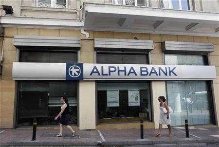 Women walk outside an Alpha bank branch in Athens August 29, 2011. REUTERS/John Kolesidis