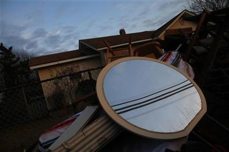 Power lines are reflected in a mirror in front of a home damaged by Hurricane Sandy on Long Beach Island, New Jersey November 10, 2012. REUTERS/Eric Thayer