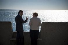 German Chancellor Angela Merkel chats with Portuguese Prime Minister Pedro Passos Coelho (L) as they stand on the terrace of Fort Sao Juliao da Barra after talks in Lisbon November 12, 2012. Merkel, who landed in Lisbon shortly before midday, was set to renew her endorsement of spending cuts and tax increases being pushed through by fellow conservative Passos Coelho to meet the terms of last year's German-backed European rescue deal for the deeply indebted Portuguese state. REUTERS/ Bundesregierung /Guido Bergmann/Pool (PORTUGAL - Tags: POLITICS) THIS IMAGE HAS BEEN SUPPLIED BY A THIRD PARTY. IT IS DISTRIBUTED, EXACTLY AS RECEIVED BY REUTERS, AS A SERVICE TO CLIENTS