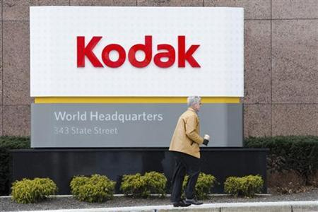 A man walks past the Kodak World Headquarters sign in Rochester, New York January 19, 2012. REUTERS/Adam Fenster/Files