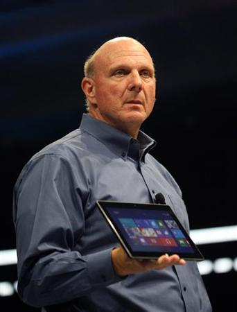 Microsoft CEO Steve Ballmer holds the new Surface as it is unveiled in Los Angeles, California, June 18, 2012. REUTERS/David McNew