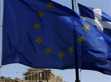 A European Union (E.U.) flag (front) and a Greek flag flutter in front of the monument of Parthenon on Acropolis hill in Athens June 17, 2012. Greeks voted on Sunday in an election that could decide whether their heavily indebted country stays in the euro zone or heads for the exit, potentially unleashing shocks that could break up the single currency. REUTERS/John Kolesidis (GREECE - Tags: POLITICS BUSINESS ELECTIONS)