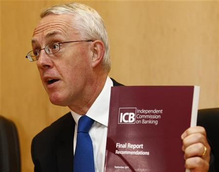 John Vickers, the head of the Independent Commission on Banking (ICB), holds a copy of his report during a news conference at the commissions headquarters in central London, September 12, 2011. REUTERS/Andrew Winning