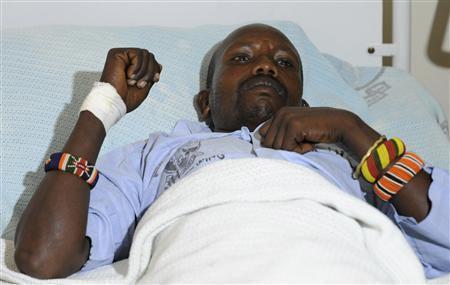 An unidentified injured policeman rests in a hospital bed in Kenya's capital Nairobi November 11, 2012, following an ambush in Baragoi. REUTERS/Stringer