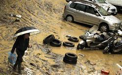 Una strada allagata in una immagine di archivio. REUTERS/Alessandro Garofalo