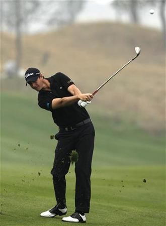 Nicolas Colsaerts of Belgium hits a shot on the second hole during the BMW Masters 2012 golf tournament at Lake Malaren Golf Club in Shanghai, October 27, 2012. REUTERS/Aly Song