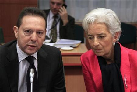 Greece's Finance Minister Yannis Stournaras (L) talks with International Monetary Fund (IMF) Managing Director Christine Lagarde at a Eurogroup meeting in Brussels November 12, 2012. REUTERS/Yves Herman