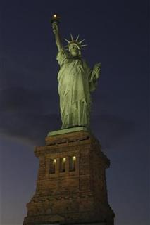 National Park Service photograph shows Statue of Liberty after it was re-lighted for the first time since Hurricane Sandy in this November 9, 2012 photo released on November 10. REUTERS/Mike Litterst/National Park Service/Handout