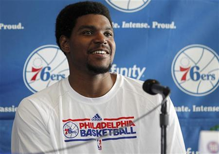 Newly-acquired Philadelphia 76ers player Andrew Bynum smiles during a news conference at the National Constitution Center in Philadelphia, Pennsylvania, August 15, 2012. REUTERS/Tim Shaffer