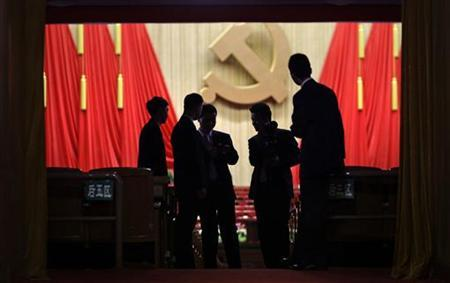 Security personnel chat after the opening ceremony of the 18th National Congress of the Communist Party of China (CPC) at the Great Hall of the People, in Beijing November 8, 2012. REUTERS/Jason Lee