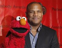 "Voice actor Kevin Clash arrives with the puppet Elmo for the 2010 Peabody Award ceremony at the Waldorf Astoria in New York in this May 17, 2010 file photo. Clash, the puppeteer who controlled the iconic ""Sesame Street"" character Elmo, took a leave of absence from the Sesame Workshop after he was accused of having a sexual relationship with a 16-year-old boy, producers said on November 12, 2012. REUTERS/Lucas Jackson/Files"