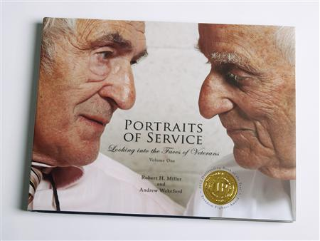 The book ''Portraits of Service: Looking into the Faces of Veterans'' is shown in this undated handout photo courtesy of Andrew Wakeford/Patton Publishing and supplied to Reuters November 9, 2012. Co-authored by Robert Miller and Andrew Wakeford it combines 70 stories of U.S. veterans from World War II to the Iraq War and the current conflict in Afghanistan. ''Portraits of Service: Looking into the Faces of Veterans''. REUTERS/Andrew Wakeford/Patton Publishing/Handout