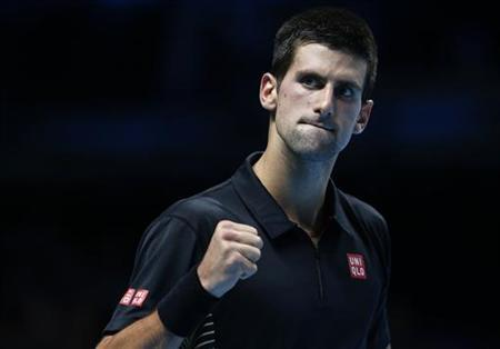 Serbia's Novak Djokovic pumps his fist during his final tennis match at the ATP World Tour Finals against Switzerland's Roger Federer at the O2 Arena in London November 12, 2012. REUTERS/Suzanne Plunkett