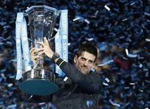 Novak Djokovic of Serbia raises the trophy after beating Switzerland's Roger Federer in their final tennis match during the ATP World Tour Finals at the O2 Arena in London November 12, 2012. REUTERS/Suzanne Plunkett