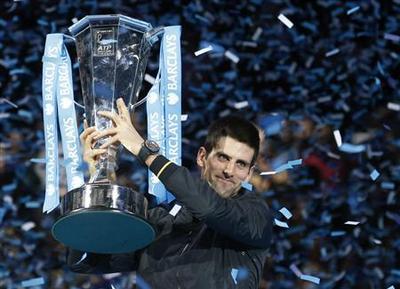 Djokovic grinds down Federer to win season finale